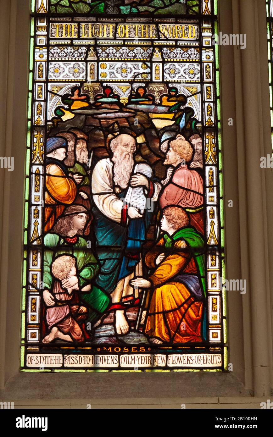 Stained glass window showing Moses and the Ten Commandments inside Saint Margaret's Church, Westminster, London, United Kingdom Stock Photo