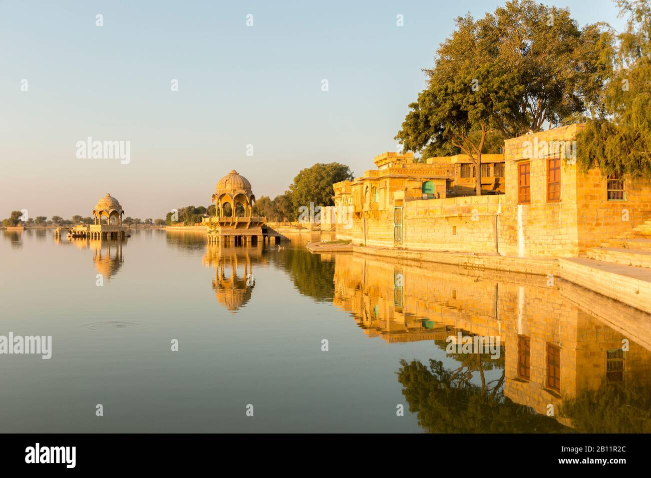 Sunrise and temple Gadi Sagar, Gadisar Lake, Jaisalmer, Rajasthan, India - Stock Photo