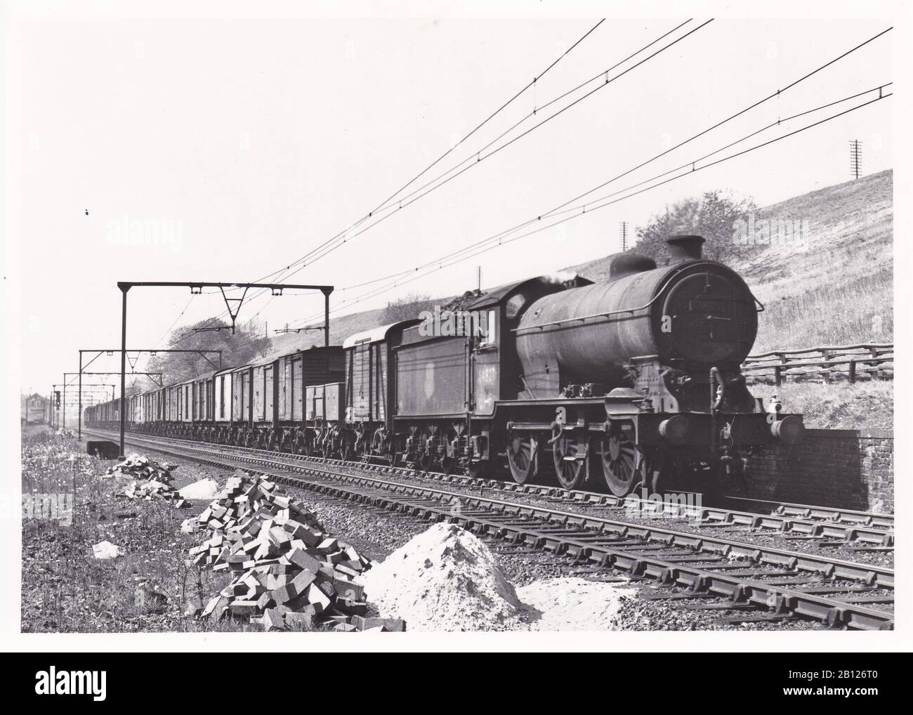 Vintage Black And White Photo Of Steam Locomotive Train E R Class J39 0 6 0 64827 On An Up Freight Passing Godley East Junction May 1954 Stock Photo Alamy