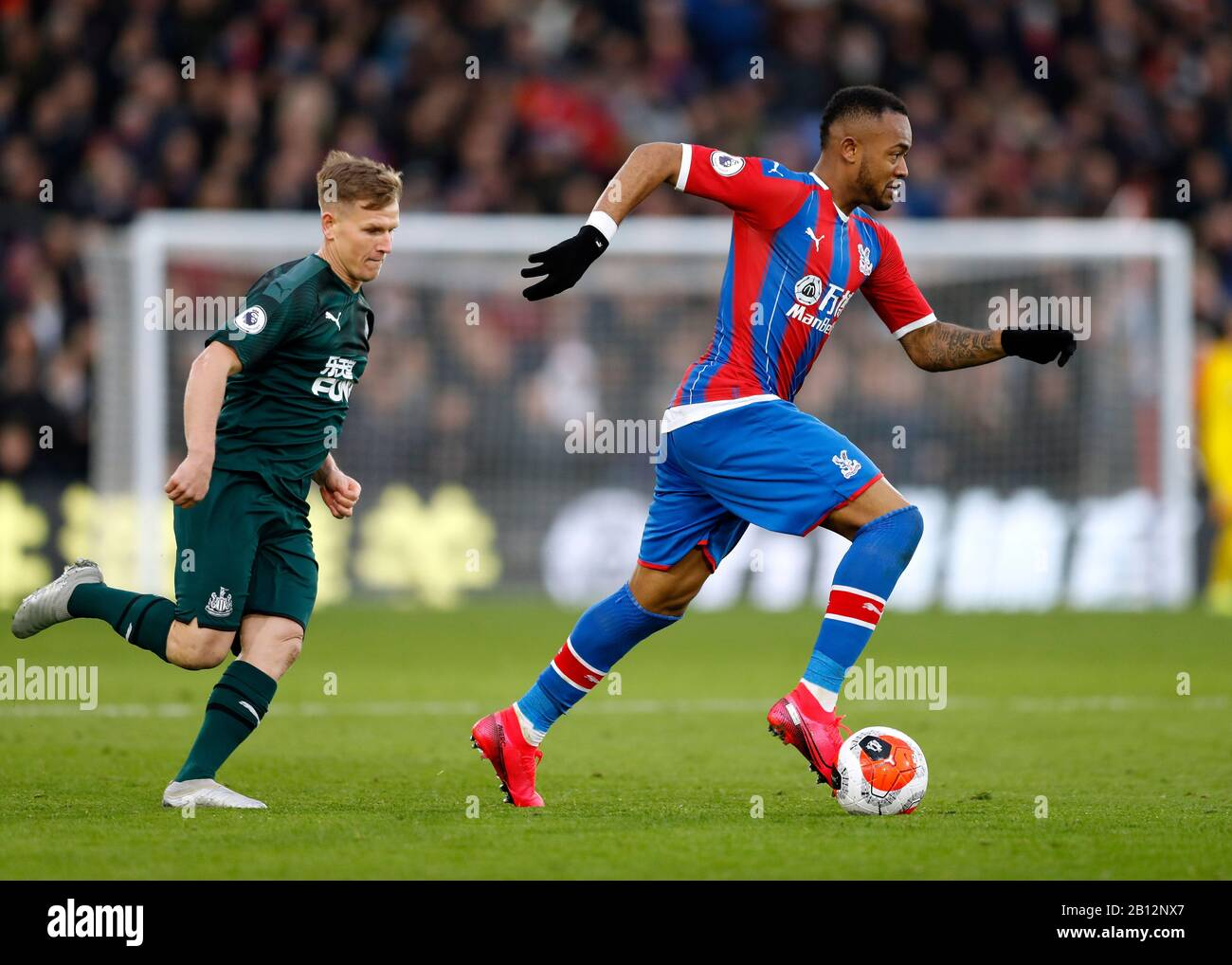 Selhurst Park, London, UK. 22nd Feb, 2020. English Premier League Football, Crystal Palace versus Newcastle United; Matt Ritchie of Newcastle United chases the run from Jordan Ayew of Crystal Palace - Strictly Editorial Use Only. No use with unauthorized audio, video, data, fixture lists, club/league logos or 'live' services. Online in-match use limited to 120 images, no video emulation. No use in betting, games or single club/league/player publications Credit: Action Plus Sports/Alamy Live News Stock Photo