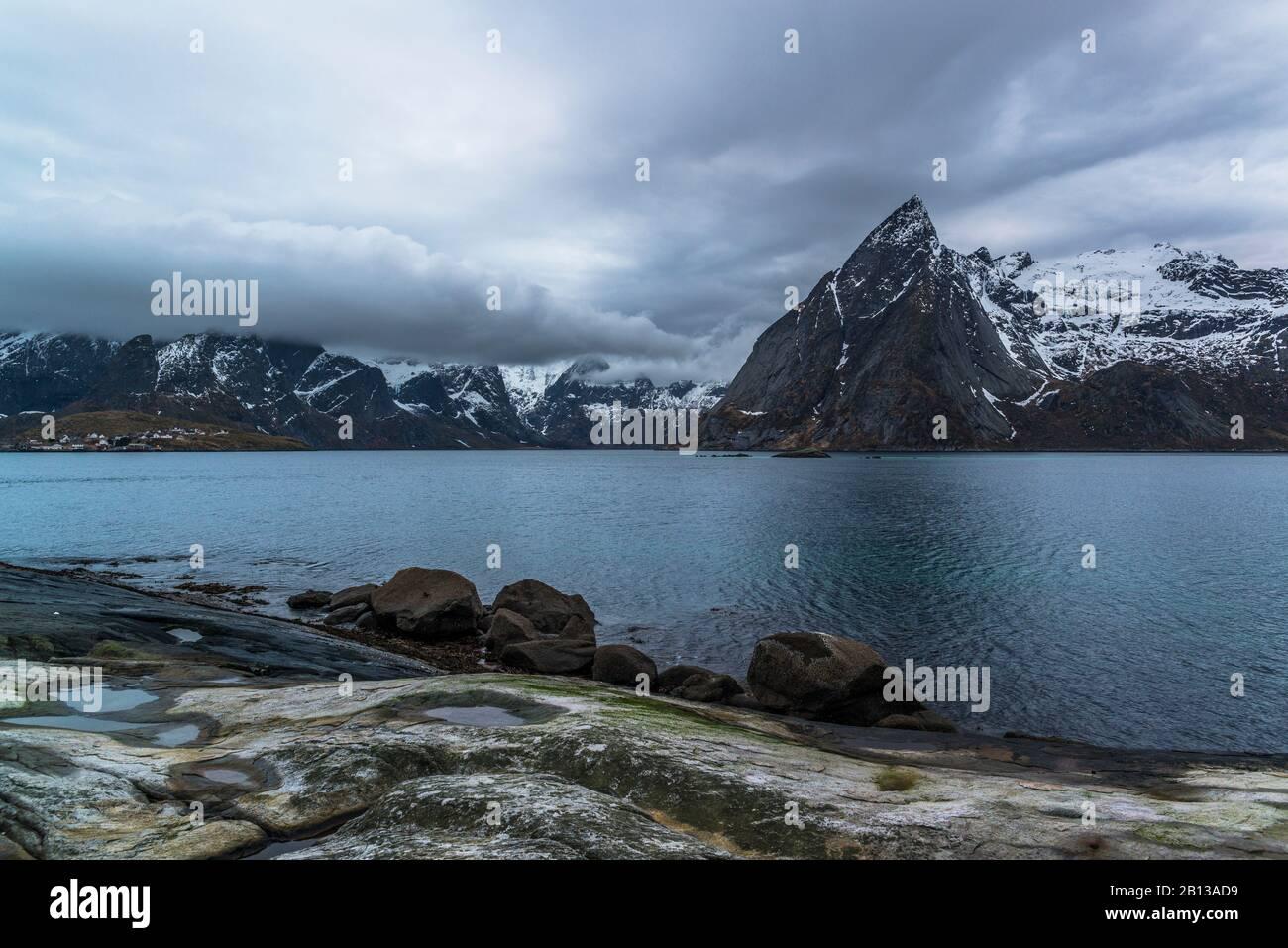 The coast of Hamnøy with the mountain Olstinden,Lofoten,Norway Stock Photo