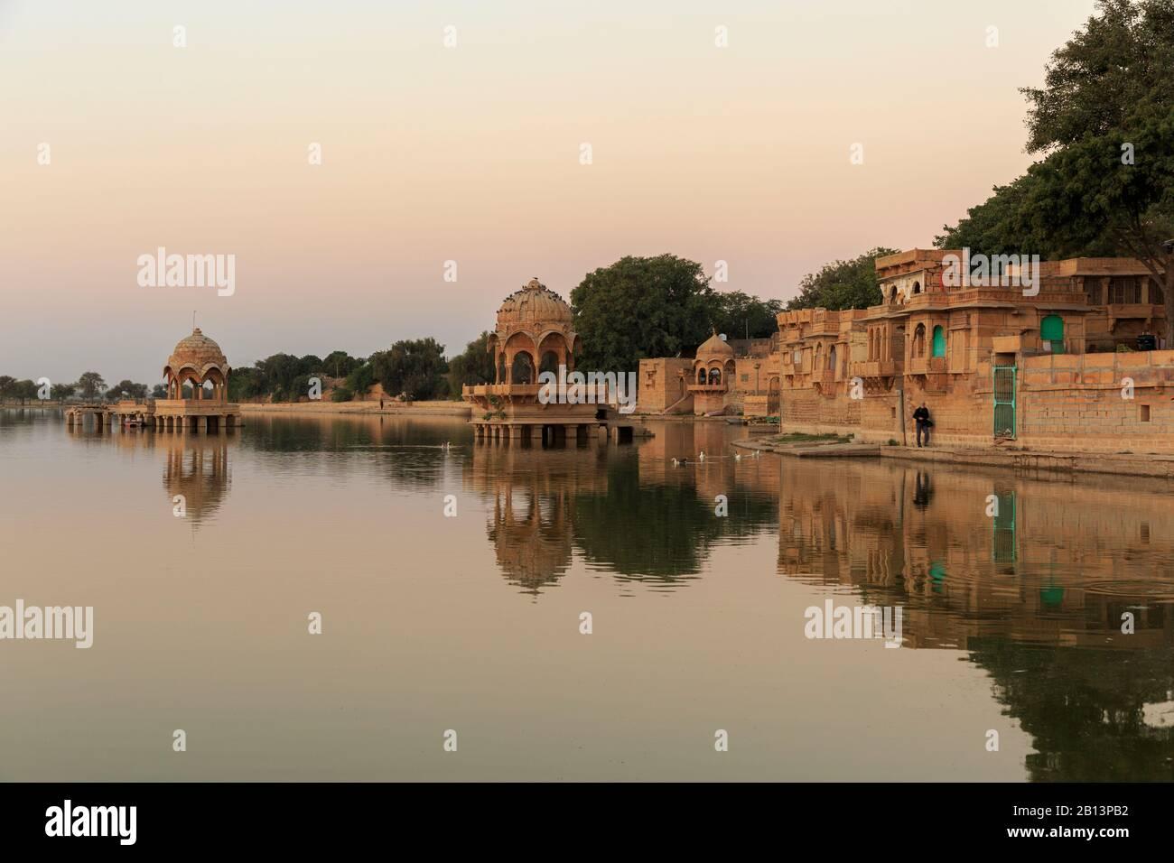 Sunrise and Temple Gadi Sagar,Gadisar Lake,Jaisalmer,Rajasthan,India Stock Photo