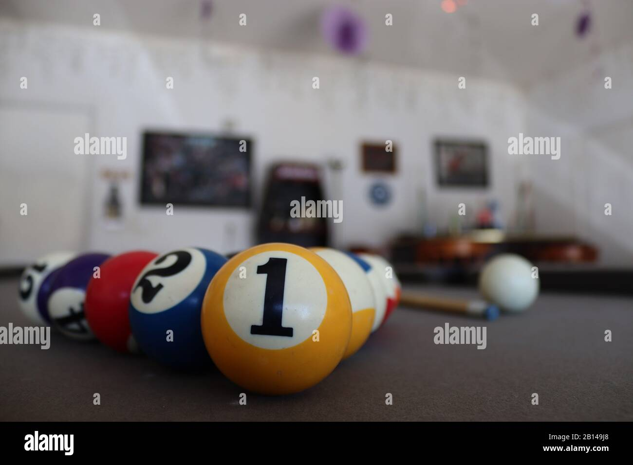 Billard Balls On A Pool Table In The Garage There Is A Bar In The Background With Pictures And Decorations Stock Photo Alamy