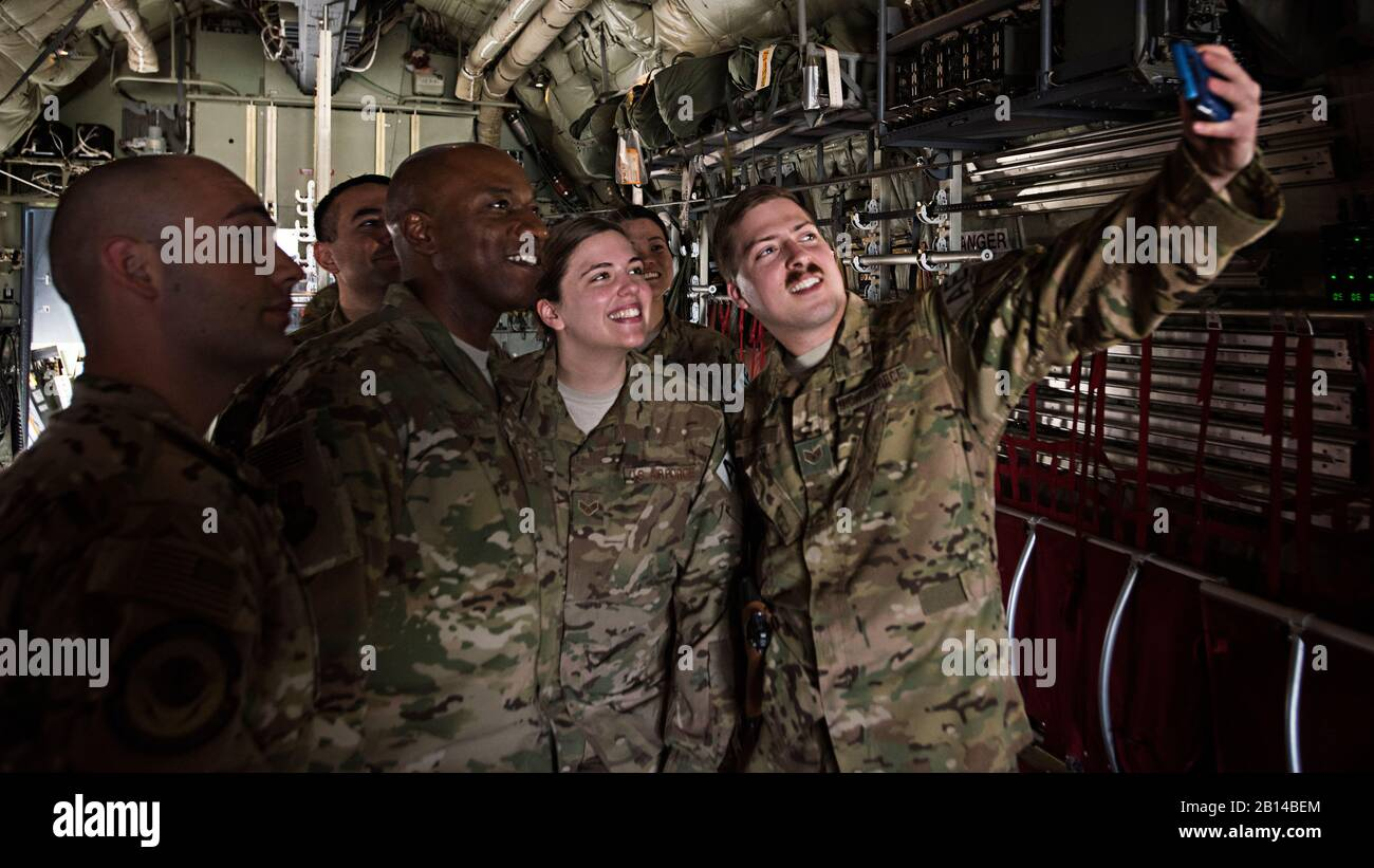 Chief Master Sgt. of the Air Force Kaleth O. Wright takes a photo with 455th Expeditionary Aeromedical Evacuation members during a tour of a C-130J Hercules aircraft April 13, 2017, at Bagram Airfield, Afghanistan. This was Wright's first visit to Bagram since being selected as the 18th chief master sergeant of the Air Force. (U.S. Air Force photo by Staff Sgt. Katherine Spessa) Stock Photo