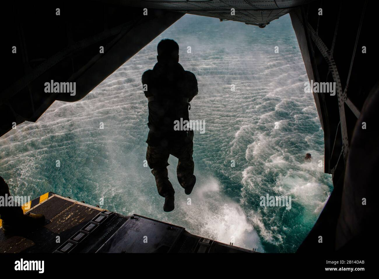 A Republic of Korea reconnaissance Marine dives off a CH-53E Super Stallion at the Sattahip district in the Chonburi province, Kingdom of Thailand, Feb. 12, 2018. Marine Heavy Helicopter Squadron 466 'Wolfpack' supported helocast training with the U.S., Thai, and ROK Marine Corps reconnaissance teams. The CH-53E Super Stallion is assigned to HMH-466, Marine Aircraft Group 16, 3rd Marine Aircraft Wing, currently forward deployed under the unit deployment program with MAG-36, 1st MAW, based out of Okinawa, Japan. Exercise Cobra Gold 2018 is an annual exercise conducted in the Kingdom of Thailand Stock Photo