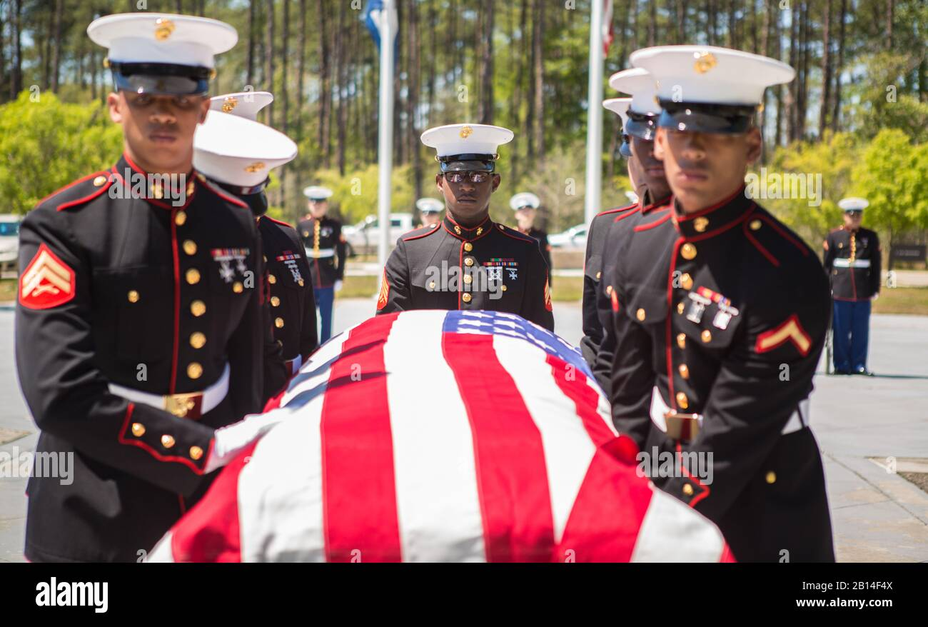 U.S. Marines with Marine Forces Reserve conduct military funeral honors for retired Lt. Col. Dennis Stegall at Southeast Louisiana Veterans Cemetery in Slidell, La., April 1, 2019. Stegall retired from the Marine Corps after 23 years of service in 2006 and continued to serve as the Marine Corps deputy comptroller for MARFORRES. (U.S. Marine Corps photo by Sgt. Dante J. Fries) Stock Photo