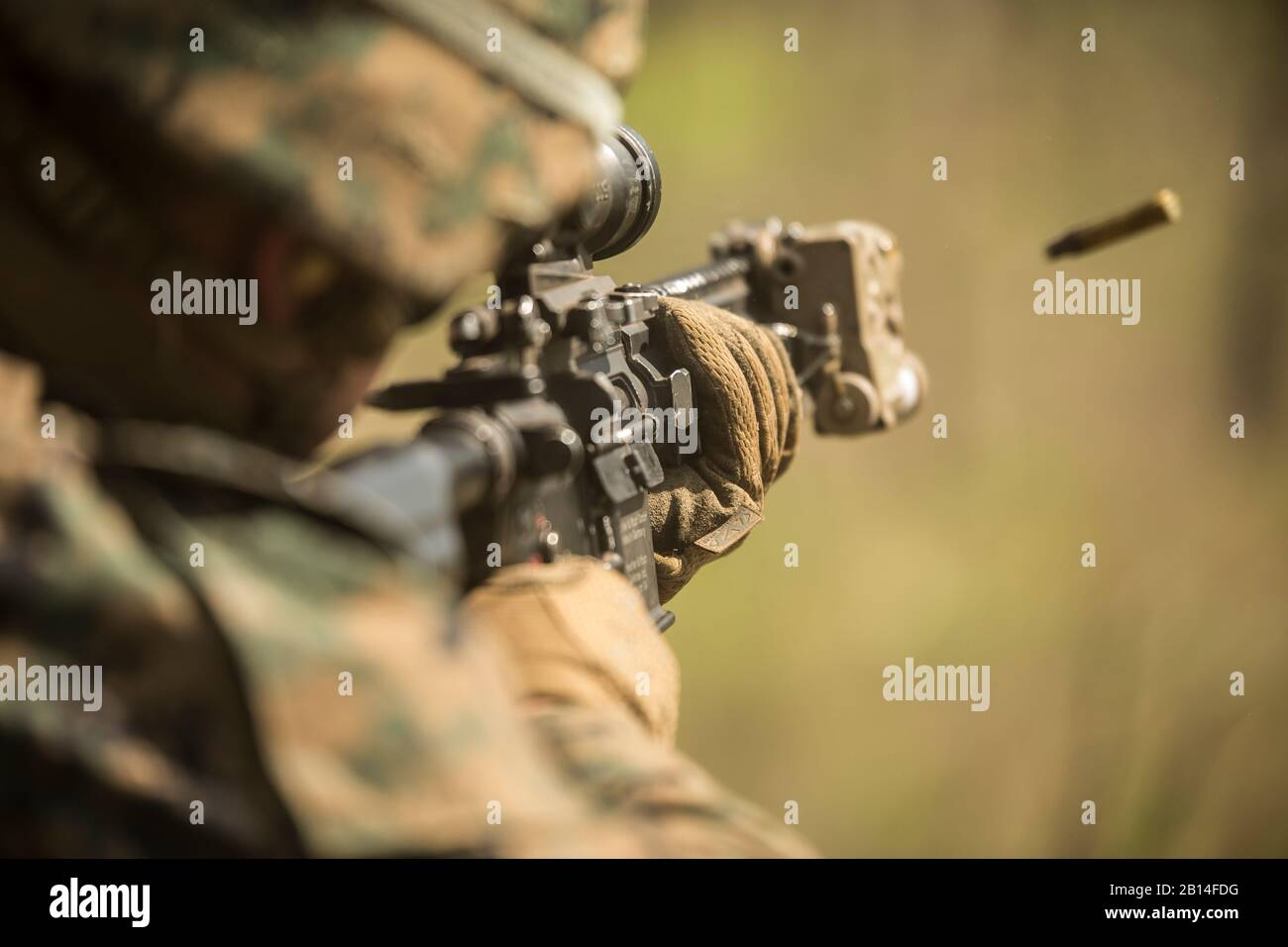 A U.S. Marine with 3rd Battalion, 3rd Marine Regiment, Marine Rotational Force – Darwin (MRF-D), fires his weapon during squad attacks at Kangaroo Flats Training Area, Northern Territory, Australia, July 25, 2019. The MRF-D rotation is a competent expeditionary fighting force that is technically proficient and capable of responding to any crisis or contingency. (U.S. Marine Corps photo by Staff Sgt. Jordan Gilbert) Stock Photo