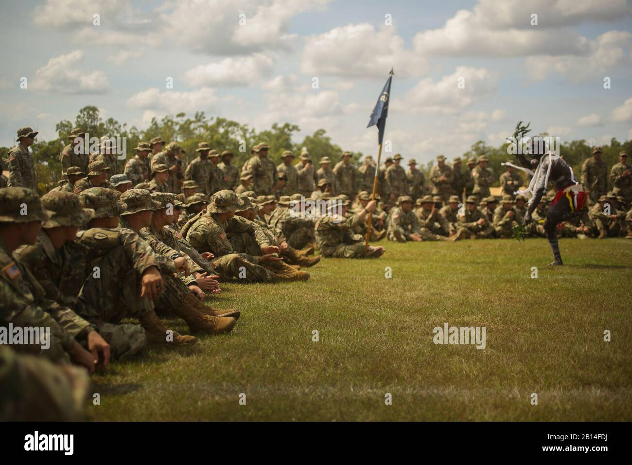 U.S. Soldiers assigned to U.S. Army Pacific enjoy a traditional dance performed by indigenous Australians during a welcome to country ceremony at Robertson Barracks, Darwin, Northern Territory, Australia, May 16, 2017. U.S. Soldiers, along with Marines assigned to Marine Rotational Force Darwin, the Japanese Ground Self-Defense Force, and the Australian Defence Force, will participate in exercise Southern Jackaroo. The training is designed to improve units' readiness, as well as improve interoperability and partnerships. (U.S. Marine Corps photo by Sgt. Emmanuel Ramos) Stock Photo