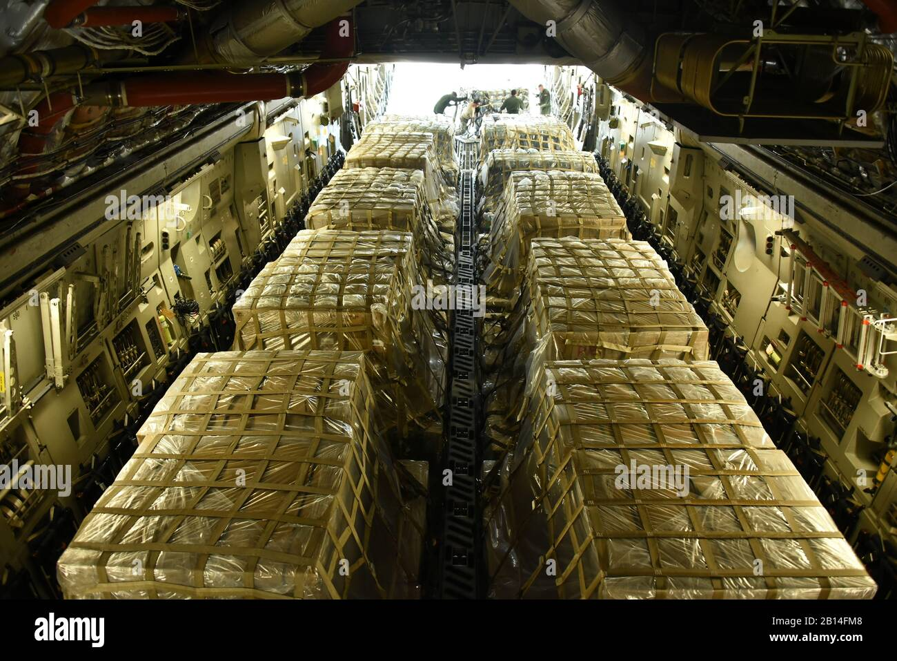 Georgia and New York National Guard Airmen load 90,000 pounds of water and meals ready to eat onto a C-17 Globemaster III at the Savannah Air National Guard Base on Sept. 27, 2017. Aircrew from the 105th Airlift Wing in New York airlifted supplies to disaster-stricken areas hit by Hurricane Maria. The Savannah Air National Guard base serves as the hub for aircraft flying to and from the disaster areas, as well as flying missions. (U.S. Air National Guard by Senior Airman Brandon Patterson) Stock Photo