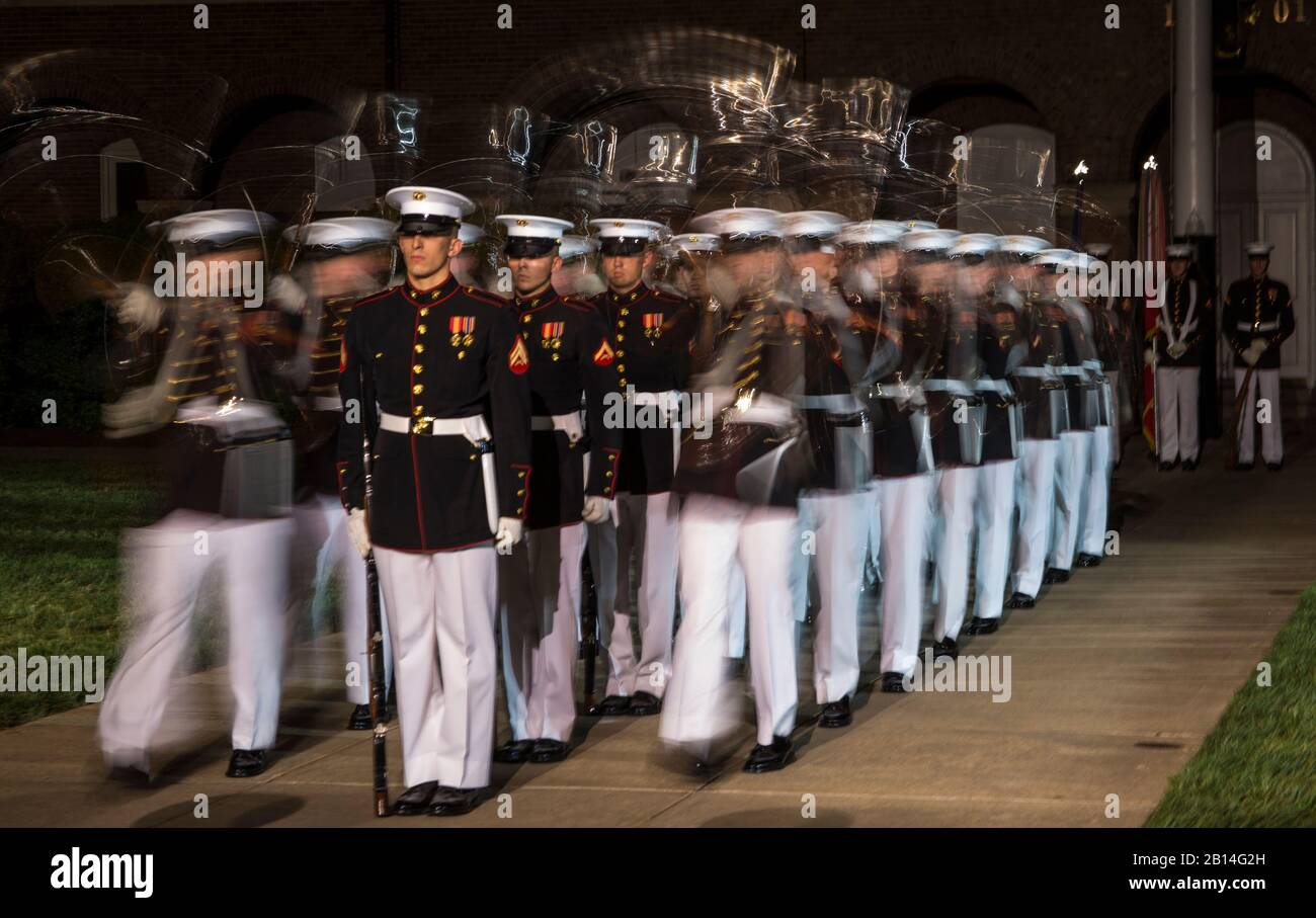 """The U.S. Marine Corps Silent Drill Platoon executes """"Meat Grinders"""" during the Friends and Family Evening Parade at the Barracks, Apr. 28, 2017. The guest of honor for the parade was the Commandant of the Marine Corps Gen. Robert B. Neller and the hosting official was the Barracks' commanding officer, Col. Tyler J. Zagurski. Stock Photo"""