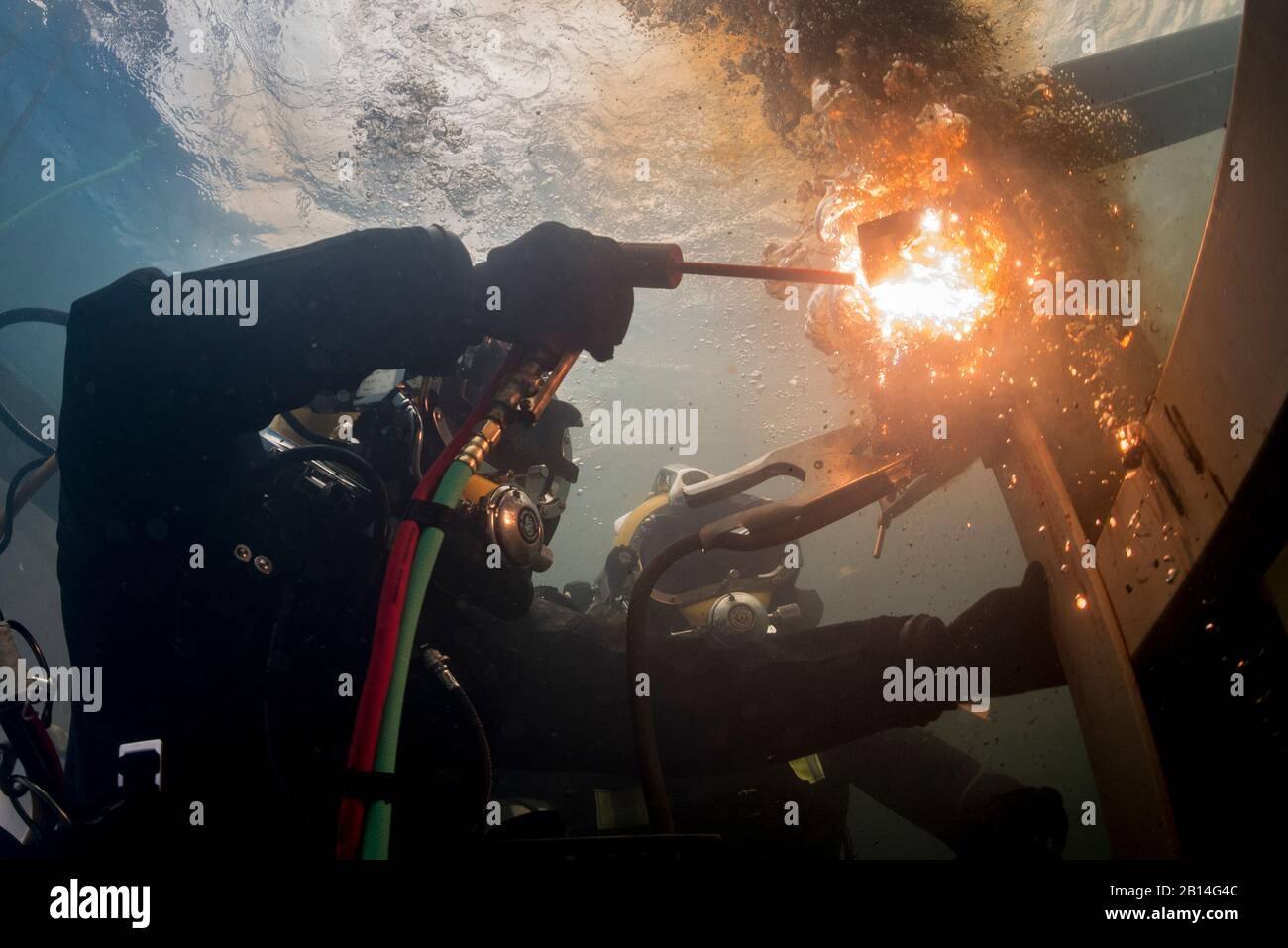 U.S. Navy Equipment Operator 3rd Class Thomas Dahlke, assigned to Underwater Construction Team 2, cuts a piece of steel in a training pool at the Republic of Korea (ROK) Naval Education and Training Command during exercise Foal Eagle in Jinhae, South Korea, March 31, 2017. Foal Eagle is an annual, bilateral training exercise designed to enhance the readiness of U.S. and ROK forces and their ability to work together during a crisis. (U.S. Navy photo by Chief Mass Communication Specialist Brett Cote) Stock Photo