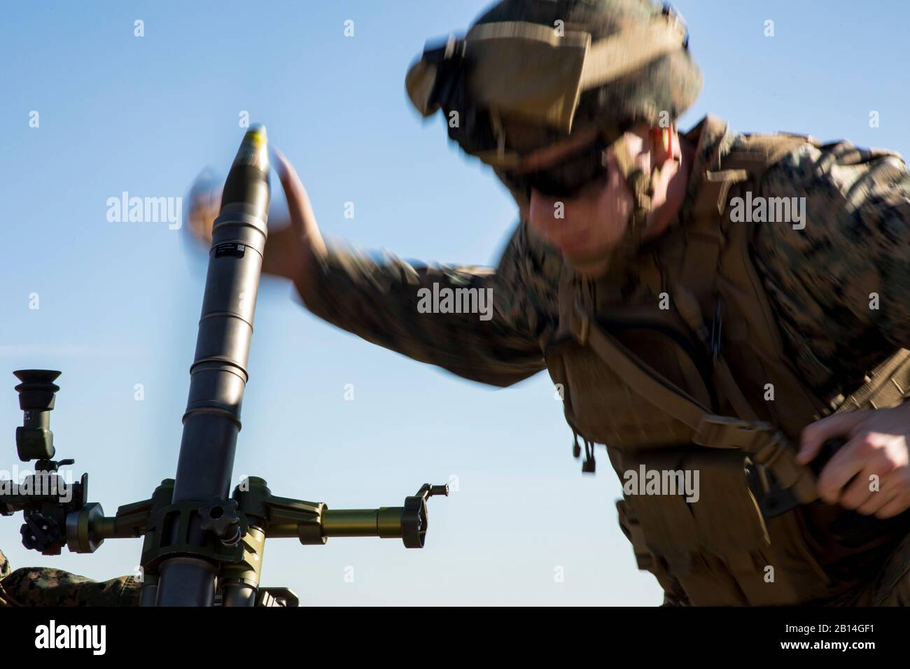 U.S. Marine Corps Lance Cpl. Dylan Sheperd, an assistant gunner, loads a round into an M224 60mm mortar system during a live-fire mortar range at Camp Lejeune, N.C., Dec. 19, 2017. The unit used the hand-held, direct lay and direct alignment methods to engage targets 1,500 meters away. This provided Marines with India Company, 3rd Battalion, 6th Marine Regiment, 2nd Marine Division the opportunity to increase their proficiency and familiarization with the weapon system. (U.S. Marine Corps photo by Cpl. Aaron Henson) Stock Photo