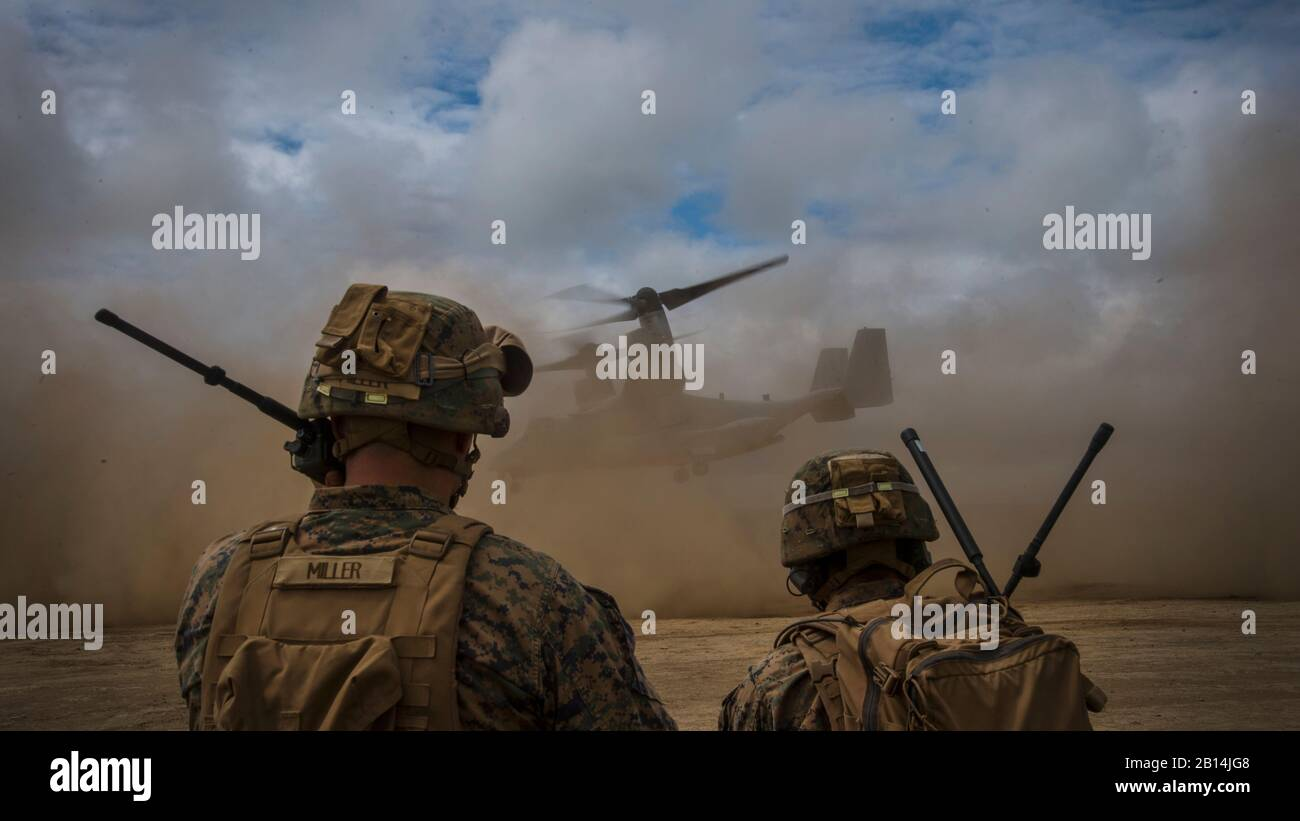 U.S. Marine Corps joint terminal attack controllers communicate with a MV-22 Osprey during takeoff in Hokkaido, Japan, Aug. 18, 2017. This specific Osprey departed from Misawa Air Base, Japan, and landed on Hokkaido for a historical Northern Viper 17 media day event with Japan Ground Self Defense Force Col. Seiichi Iwana, deputy commander of Japan Ground Self-Defense Force 11th Brigade, and Col. James F. Harp, the commanding officer of Marine Aircraft Group 36, 1st Marine Aircraft Wing. Misawa AB has been a hub for U.S. Marine personnel and aircraft, exercising Team Misawa's ability to thrive Stock Photo