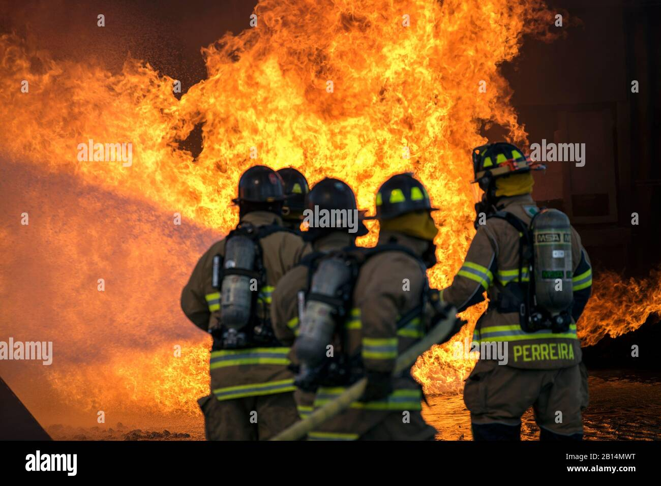 Firefighters assigned to the U.S. Air Force 23rd Civil Engineer Squadron (CES) extinguish an aircraft fire during live-fire training, April 24, 2018, at Moody Air Force Base, Georgia. Firefighters from the 23d CES and Valdosta Fire Department participated in the training to gain more experience fighting aircraft fires and to work together as a cohesive team while still practicing proper and safe firefighting techniques. (U.S. Air Force photo by Airman 1st Class Eugene Oliver) Stock Photo