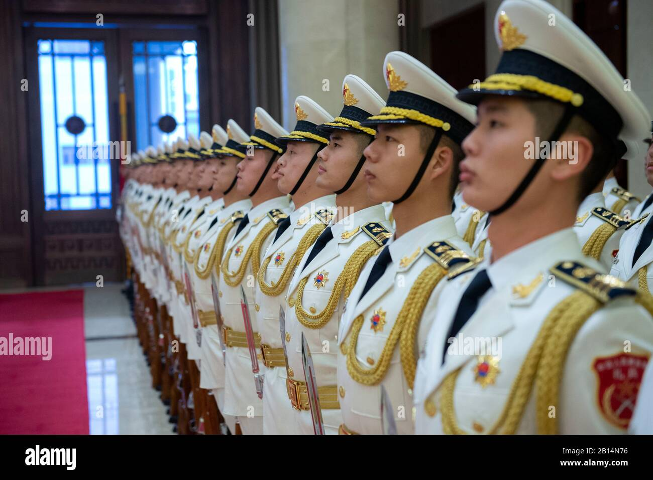 Chinese sailors stand in formation before a visit by Chief of Naval Operations (CNO) Adm. John Richardson to the People's Liberation Army (Navy) (PLA(N)) headquarters in Beijing Jan. 14, 2019. Richardson is on a three-day visit to Beijing and Nanjing to continue the ongoing dialog between the two heads of navy and encourage professional interactions at sea, specifically addressing risk reduction and operational safety measures to prevent unwanted and unnecessary escalation. (U.S. Navy Photo by Chief Mass Communication Specialist Elliott Fabrizio) Stock Photo