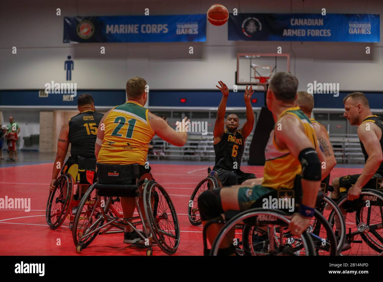 U.S. Army Spc. Brent Garlic, retired, participates in the Wheelchair Basketball Prelim event of the Department of Defense Warrior Games competition at The Tampa Convention Center in Tampa, Fla., June 24, 2019. The Warrior Games are a collection of adaptive sports competitions for wounded, ill and injured service members and veterans. Approximately 300 athletes representing teams from the Army, Marine Corps, Navy, Air Force, Special Operations Command, United Kingdom Armed Forces, Australian Defence Forces, Canadian Armed Forces, Armed Forces of the Netherlands, and the Danish Armed Forces will Stock Photo