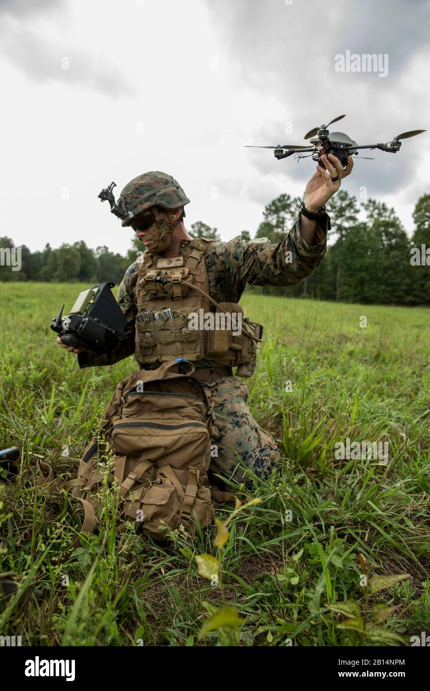 U.S. Marine Corps Lance Cpl. Ryan Skinner, assistant patrol leader, with Company Bravo, 1st Battalion, 6th Marine Regiment prepares to fly the Mark-2 Instant Eye during the Infantry Platoon Battle Course as part of a Deployment for Training (DFT) on Fort Pickett, VA., August 15, 2017. The Instant Eye is a small unmanned aerial system used to be deployed at the squad level for quick and local surveillance and reconnaissance. (U.S. Marine Corps photo by Lance Cpl. Michaela R. Gregory) Stock Photo