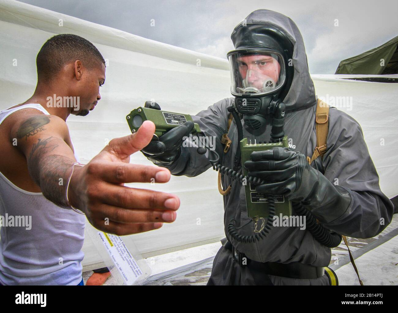 U.S. Army Spc. Nicholas Threatte, a chemical decontamination specialist and native of Darlington, South Carolina, assigned to the Army Reserve 413th Chemical Company, 457th Chemical Battalion, 415th Chemical Brigade, Task Force 76, checks radiation levels on a simulated victim of a chemical attack during a training exercise at Homestead Miami Speedway, Homestead, Florida, Jan. 24, 2019, as part of Operation Homestead 19. Nearly 300 Army Reserve Soldiers assigned to Task Force 76 along with more than 100 personnel from the Miami-Dade Fire Department and several other civilian agencies spent the Stock Photo