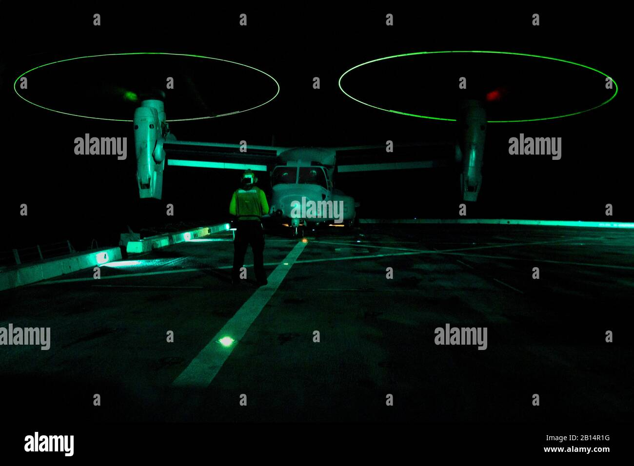 SOUTH CHINA SEA (August 2, 2017) Aviation Support Equipment Technician 3rd Class Angus Moss, a native of Columbus, Indiana, assigned to the Air department aboard the amphibious tranport dock ship USS San Diego (LPD 22), directs an MV-22B Osprey, assigned to Marine Medium Tiltrotor Squadron 161 (reinforced), on the ship's flight deck. San Diego, part of the America Amphibious Ready Group, with embarked 15th Marine Expeditionary Unit, is operating in the Indo-Asia Pacific region to strengthen partnerships and serve as a ready-response force for any type of contingency. (U.S. Navy photo by Mass C Stock Photo