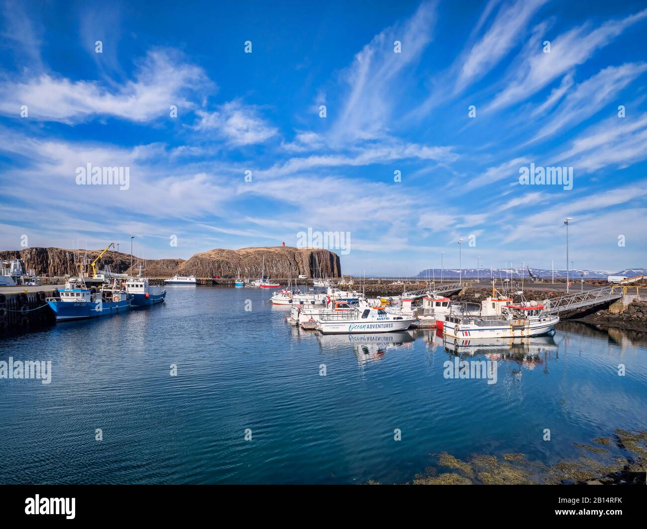 16 April 2018: Stykkisholmur, Iceland - Boats moored in the harbour at Stykkisholmur, on the Snaefellsnes Peninsula, West Iceland. Stock Photo