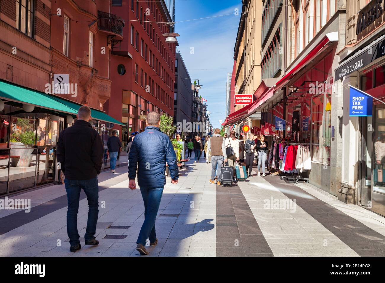 16 September 2018: Stockholm, Sweden - Shoppers and tourists  in Drottninggatan on a bright sunny autumn weekend. Stock Photo