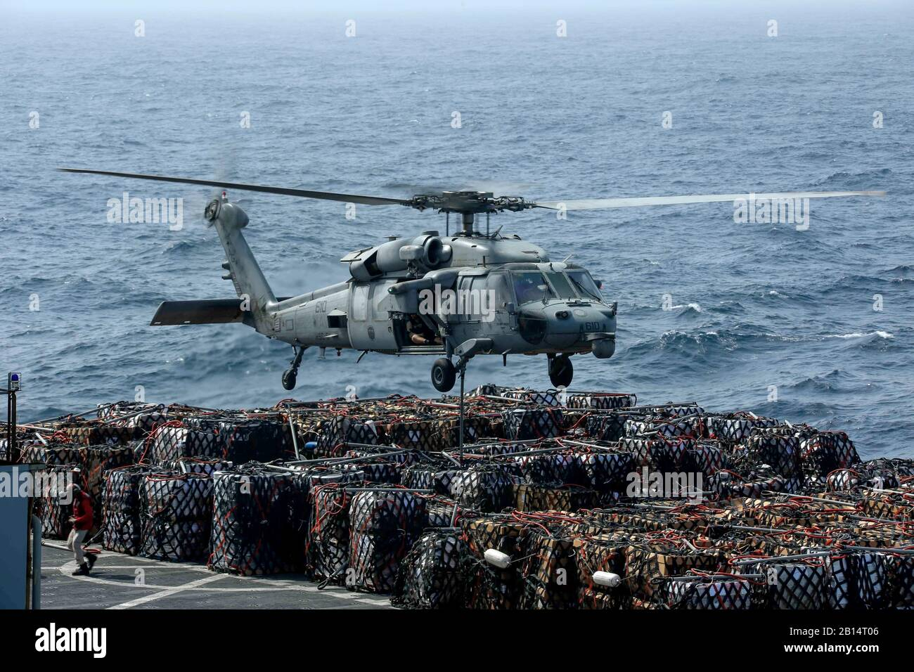 190621-N-FK070-1312  ARABIAN SEA (June 21, 2019) An MH-60S Sea Hawk helicopter from the Nightdippers of Helicopter Sea Combat Squadron (HSC) 5 transports cargo from the dry cargo and ammunition ship USNS Alan Shepard (T-AKE 3) to the Nimitz-class aircraft carrier USS Abraham Lincoln (CVN 72) during a vertical replenishment-at-sea. The Abraham Lincoln Carrier Strike Group is deployed to the U.S. 5th Fleet area of operations in support of naval operations to ensure maritime stability and security in the Central Region, connecting the Mediterranean and the Pacific through the western Indian Ocean Stock Photo