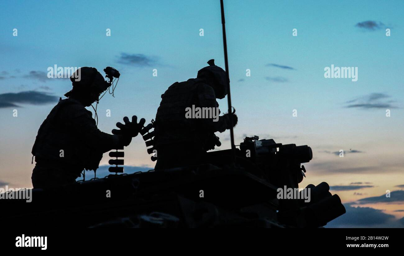 U.S. Soldiers from Alpha Company, 1st Battalion, 111th Infantry, 56th Stryker Brigade Combat Team prepare rounds while anticipating the start of the live-fire iteration of the Combined Arms Live Fire Exercise during Exercise Decisive Strike 2019 at the Training Support Centre, Krivolak, North Macedonia, June 11, 2019. Combined training enables allies and partners to respond more effectively to regional crises and meet their own national defense goals. (U.S. Army photo by Pfc. Ashunteia' Smith) Stock Photo