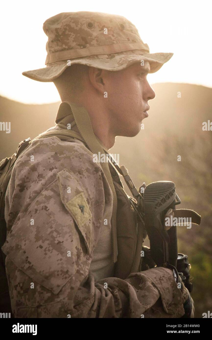 U.S. Marine Corps Lance Cpl. Riley Crider, a machine gunner assigned to Kilo Company, Battalion Landing Team 3/1, 13th Marine Expeditionary Unit, waits for orders during a fire team maneuver drill while participating in Theater Amphibious Combat Rehearsal (TACR) 18 in Djibouti Sept. 8, 2018. Led by Naval Amphibious Force, Task Force 51/5th Marine Expeditionary Brigade, TACR integrates U.S. Navy and Marine Corps assets to practice and rehearse a range of critical combat-related capabilities available to U.S. Central Command, both afloat and ashore, to promote stability and security in the regio Stock Photo