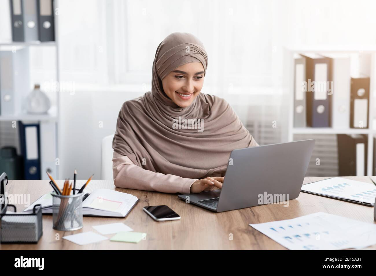 Young muslim businesswoman working on her laptop in office Stock Photo