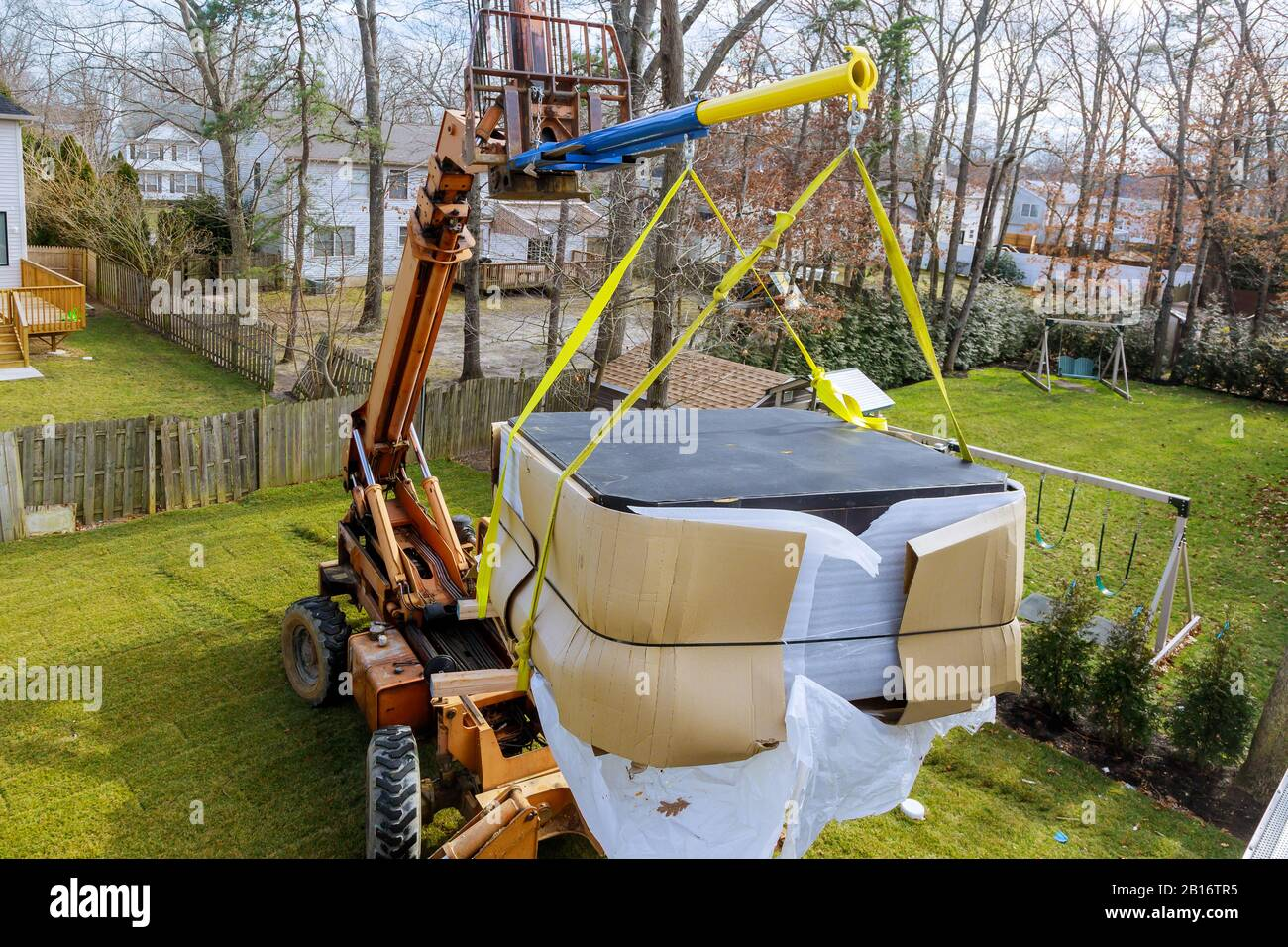 Construction details in progress boom truck forklift scale weight above blue sky with jacuzzi Stock Photo