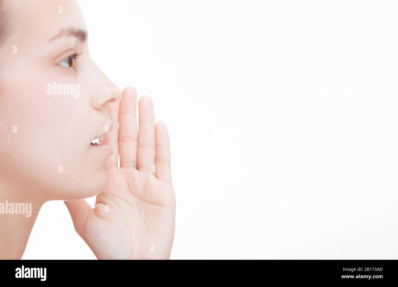 Close up of female mouth isolated on white background Stock Photo