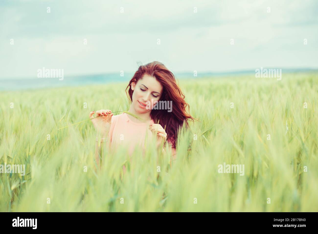 Enjoying Nature Beautiful Happy Woman Girl Outdoors On Green Wheat Field In Summer Nature Attractive Beauty Girl Outside In Nature Cute Stock Photo Alamy