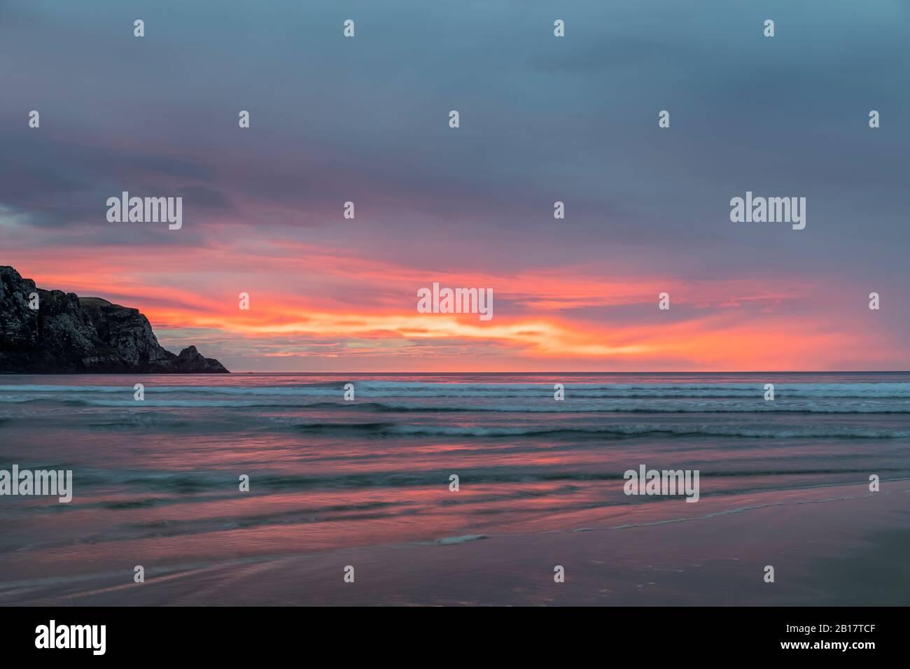 New Zealand,PurakaunuiBay at cloudy sunrise Stock Photo
