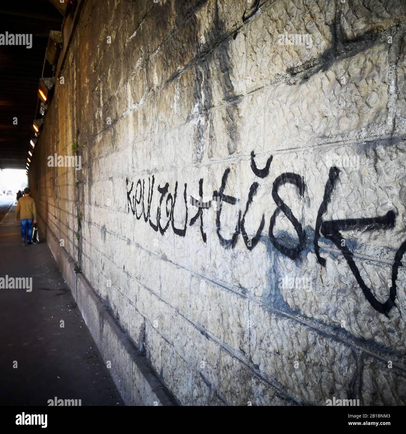 Stone wall with a graffiti, Lyon, France Stock Photo