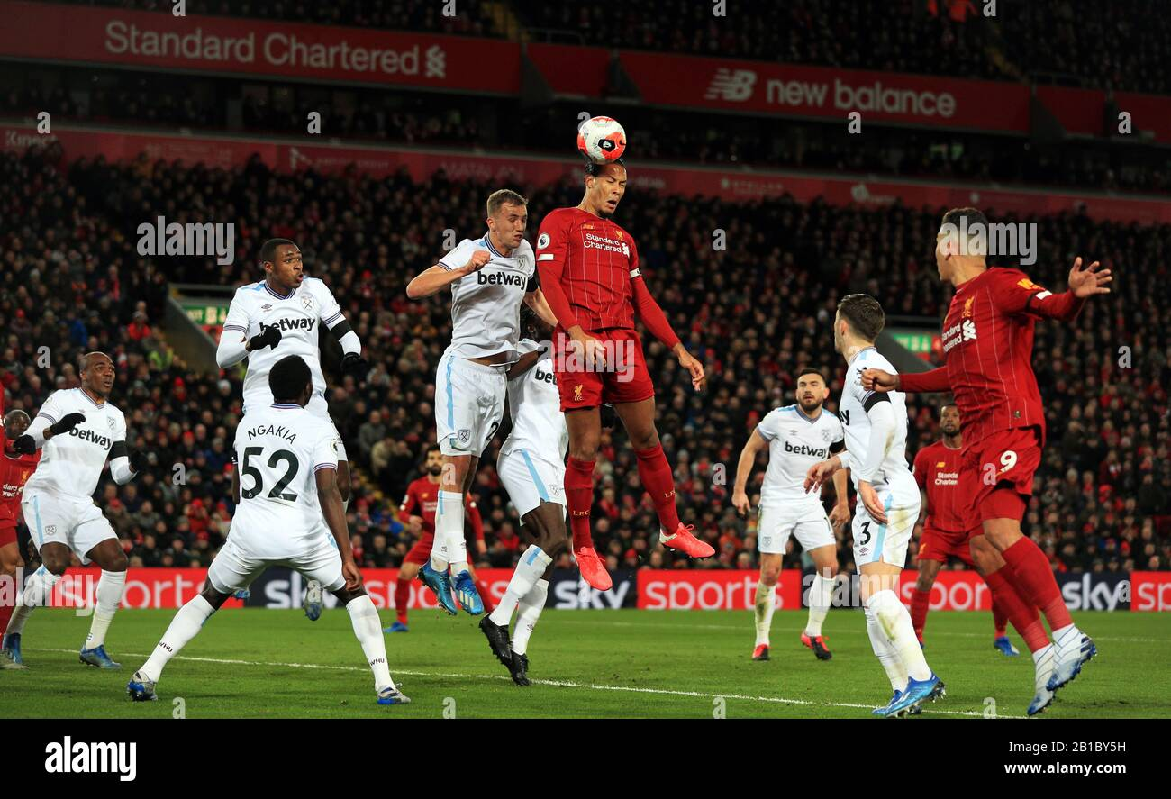 Liverpool S Virgil Van Dijk Centre Sees His Header Hit The Crossbar During The Premier League Match At Anfield Liverpool Stock Photo Alamy