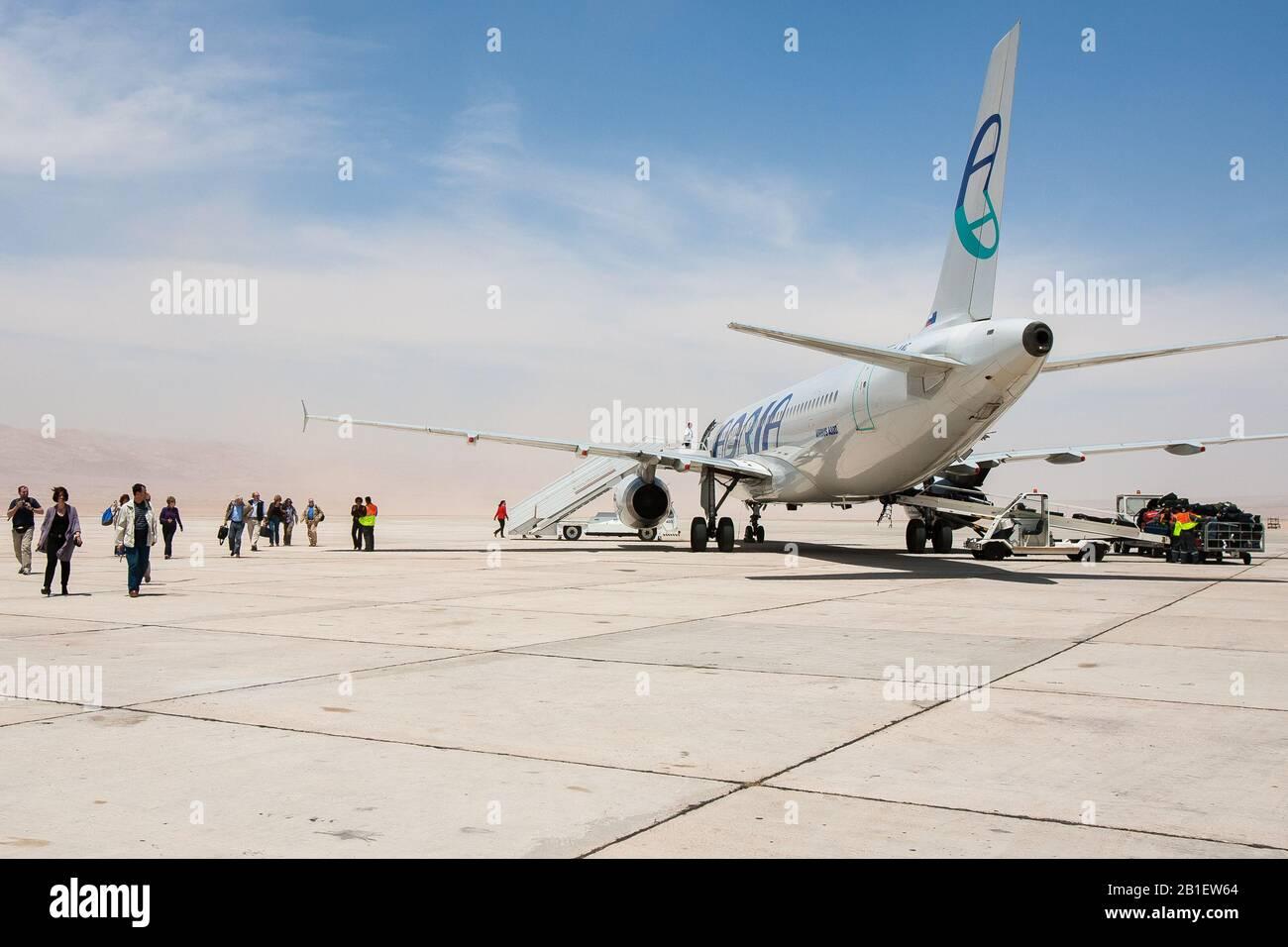 Aqaba, Jordan, April 27, 2009: A Slovenian Adria Airways airplane sits on the tarmac of the King Hussein International Airport in Aqaba, Jordan. Stock Photo
