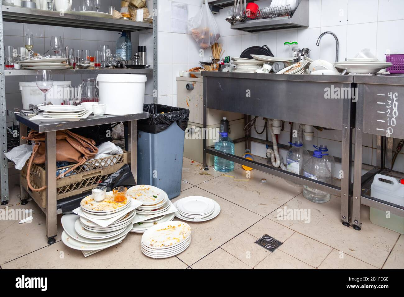 Stacks Of Dirty Dishes Crockery Many Glasses Appliances With Leftover Food On Professional Restaurant Kitchen In Metal Sink Shelves Garbage On Fl Stock Photo Alamy