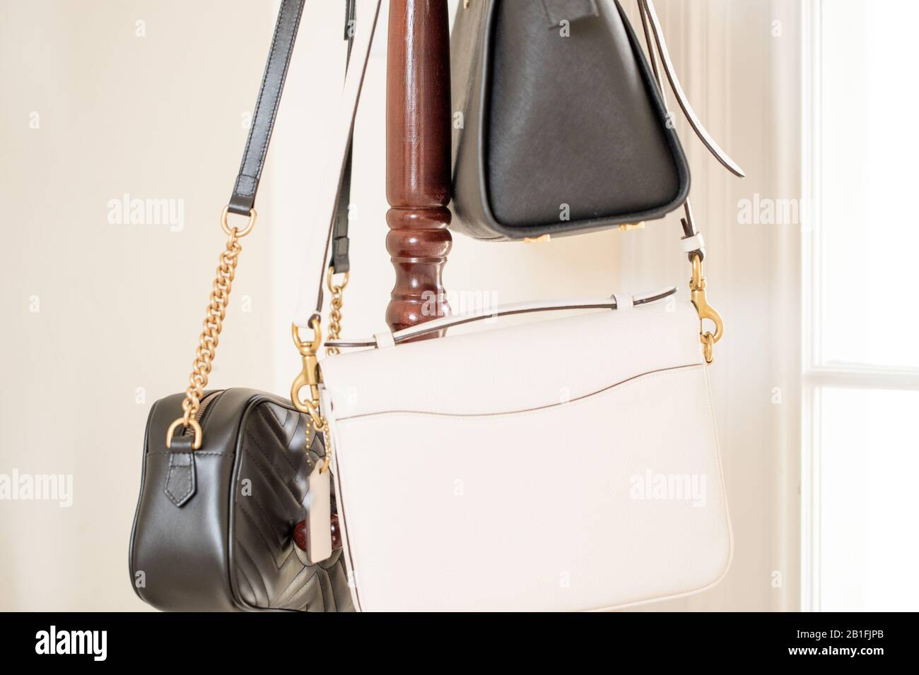 handbag is hanging brown shelf - Image Stock Photo