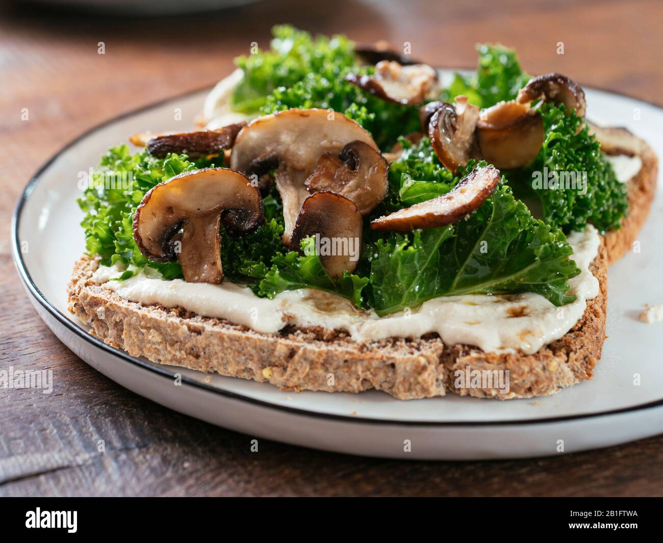Mushrooms and Kale with Vegan Ricotta on Toast Stock Photo   Alamy