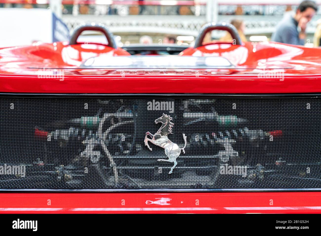 22 Feb 2020 - London, UK. Ferrari emblem and see-through mesh to an engine compartment. Stock Photo