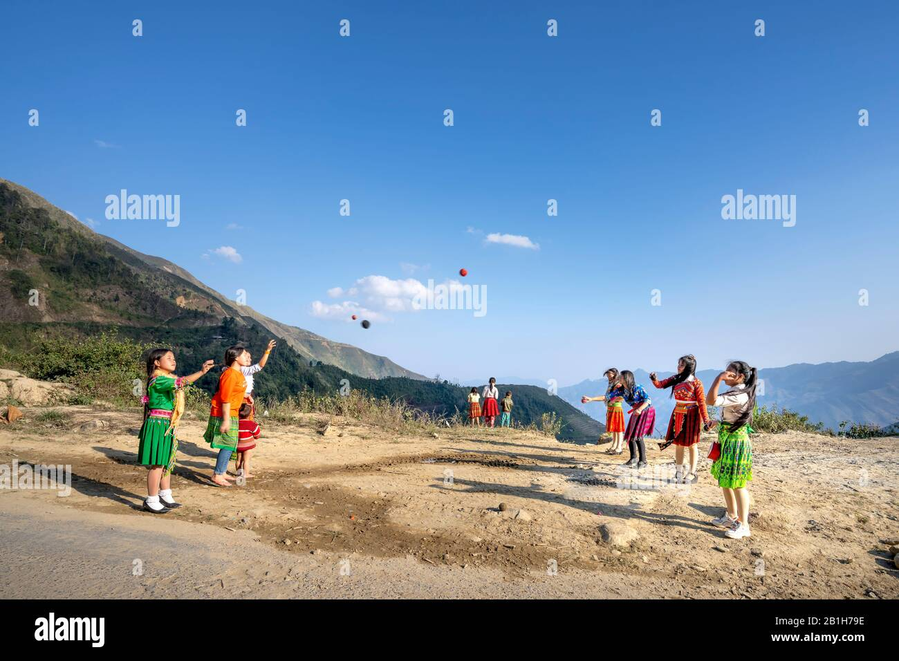 Ta Xua, Son La province, Vietnam - January 21, 2020: H'mong children play handball in Son La, Vietnam. At the time of the Lunar New Year at the end of Stock Photo