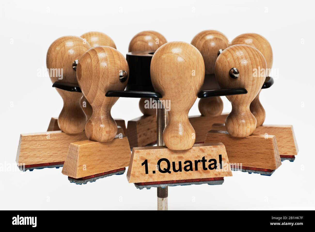 a stamp with the inscription 1. Quartal (1st quarter) hangs in a stamp rack Stock Photo