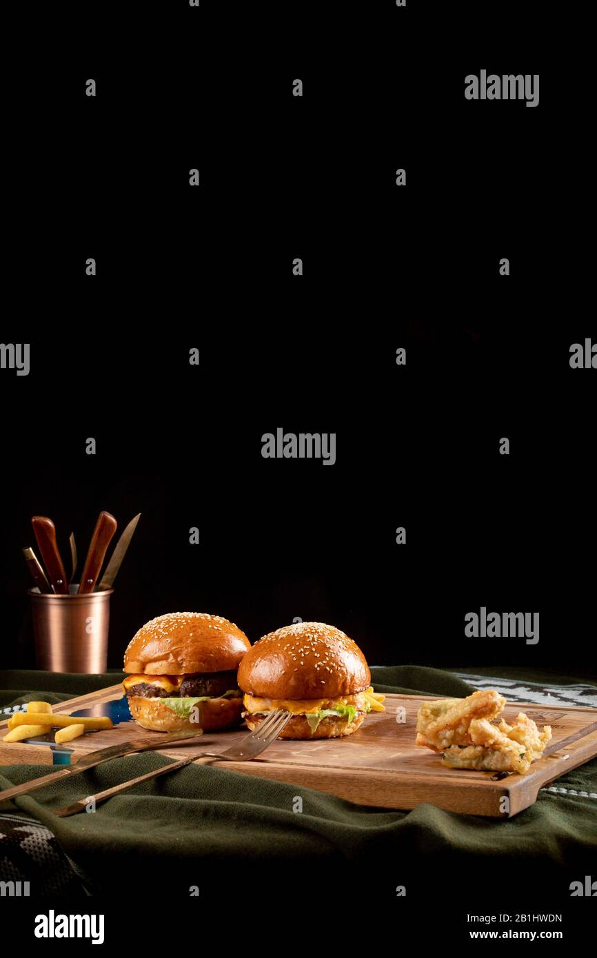 two Gourmet Tasty Steak Burgers on a Wooden Tray. Stock Photo