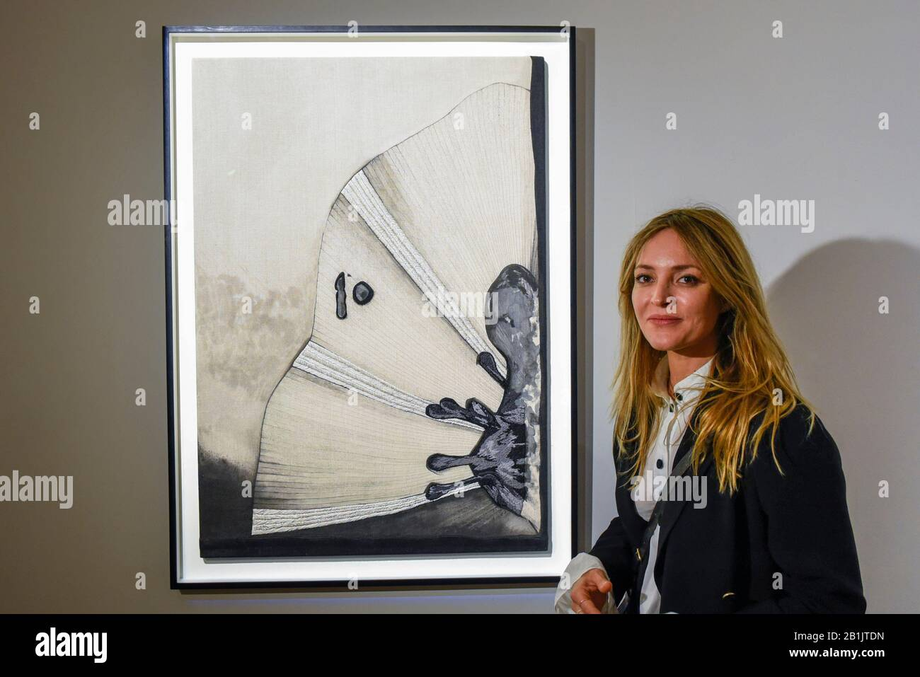 """London, UK.  26 February 2020. Artist Carolina Mazzolari poses with her work called """"Void"""", 2019 (Starting price GBP3,000). Preview of """"Human Touch"""", an exhibition of one-of-a-kind artworks by international contemporary artists in collaborations with stitchers in British prisons.  In association with the charity Fine Cell Work, the artworks are on show at Sotheby's New Bond Street 26 February to 3 March 2020.  Credit: Stephen Chung / Alamy Live News Stock Photo"""