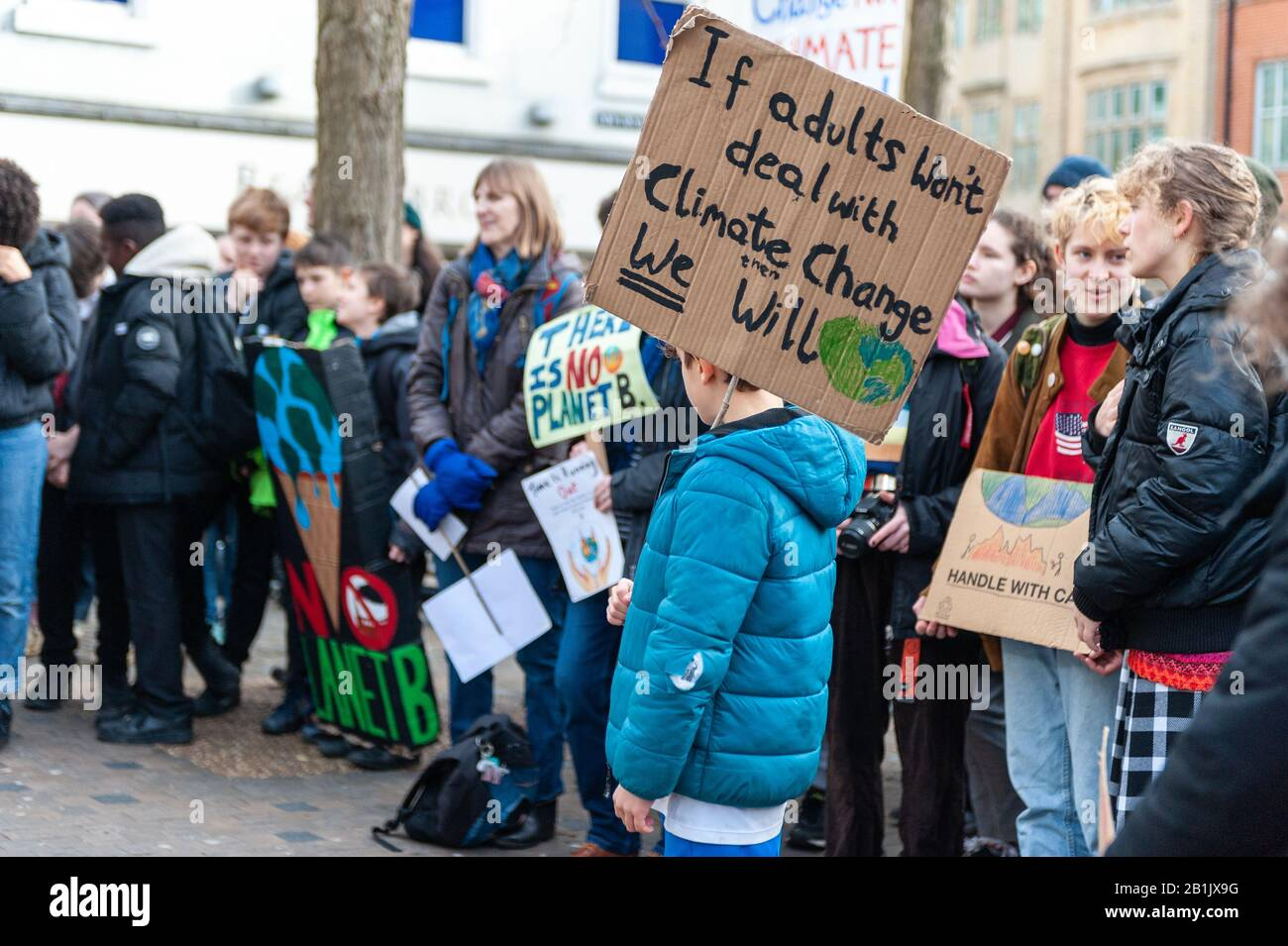 A young protester calling for adults to take Climate Change seriously at the Valentine's Day Youth Climate Strike in Oxford, United Kingdom, on the anniversary of the first UK youth strike for climate in 2019. Stock Photo