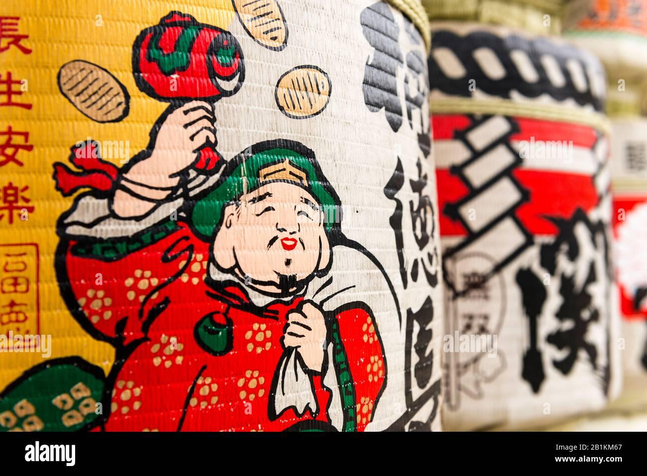 Sake barrels covered in Japanese art, at Kushida-jinja,  a Shinto shrine. Hakata-ku Old Town, Fukuoka. Japan Stock Photo