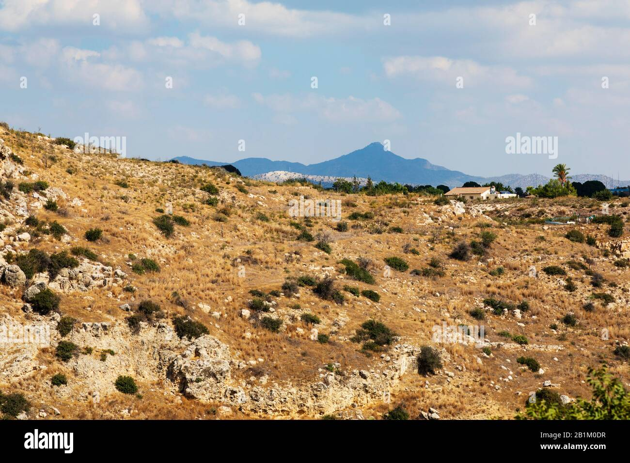 Wasteland behind the neolithic settlement of Choirokoitia, with Stavrovouni monestery in the distance.  Cyprus. Cyprus 2018. Stock Photo