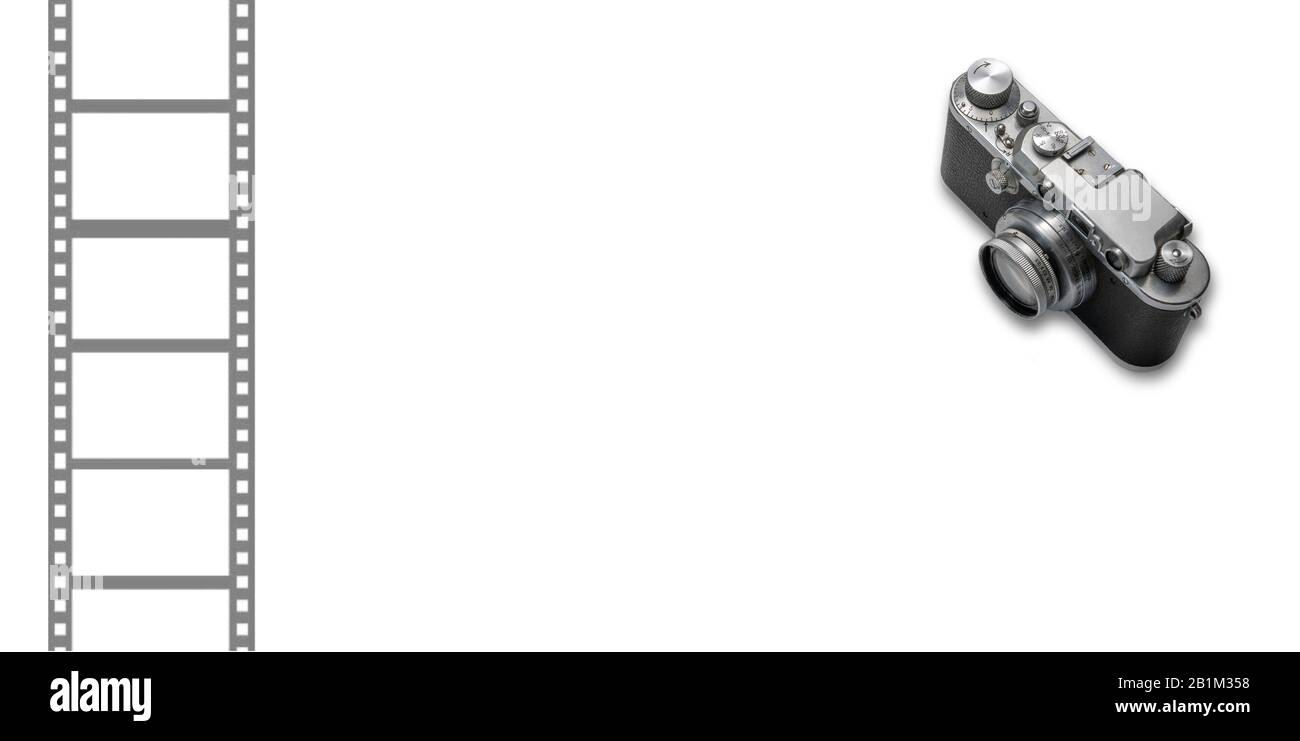 A vintage photo camera on a white background. Stock Photo