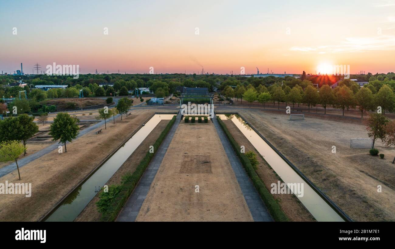 Oberhausen, North Rhine-Westfalia, Germany - August 06, 2018: Sunset over the Ruhr Area, seen from the lookout tower at the Olga-Park Stock Photo