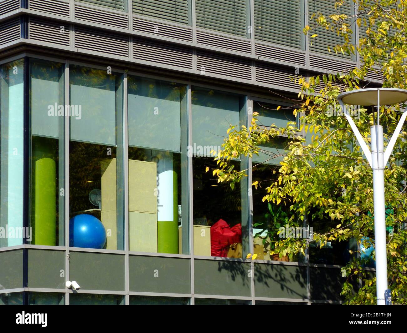 Glass And Aluminum Curtain Wall Exterior Detail Of Office Building With Yellow Autumn Tree And Street Lamp Design And Modern Architecture Urban Life Stock Photo Alamy